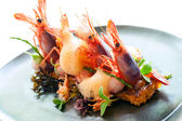 Queen prawns with paella rice. — Stock Photo