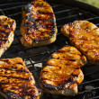 Stock Photo: T-bone steak cooking on open flame grill