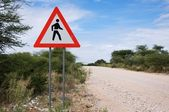Danger sign: crossing road — Stock Photo