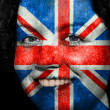 Woman with flag painted on her face to show UK support — Stock Photo