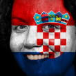 Woman with flag painted on her face to show Croatia support - Stock Photo