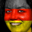 Woman with flag painted on her face to show German support — Stock Photo