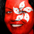 Woman with flag painted on her face to show Hong Kong support — Stock Photo