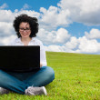 Woman working outdoors sitting up — Stock Photo