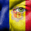 Flag painted on face with green eye to show Andorra support — Stock Photo