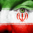 Flag painted on face with green eye to show Iran support — Stock Photo