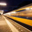 Train leaving train station — Stock Photo