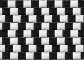 Optical illusion with black and white pillows — Stock Photo