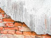 Old, ragged brick wall texture — Stockfoto