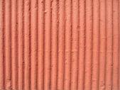 Textured orange plaster wall — Stock Photo
