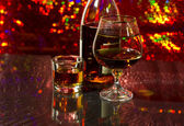 Brandy in a bottle and glass. — Стоковое фото