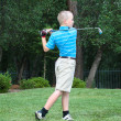 Stock Photo: Young male teen golfer with great form
