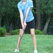 Pretty female teen golfer with extraordinary form — Stock Photo