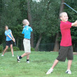 Three Young golfers – family fun — 图库照片
