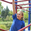 Foto Stock: Apprehensive preteen female on bars