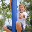 Boy on pole with victory / peace sign — Stock Photo