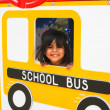 Hispanic Preschooler on playground bus — Stock Photo #11735926