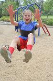 Happy teen girl on swing — Stock Photo