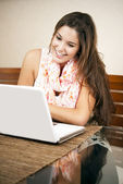 Pretty student using her laptop — Stock Photo