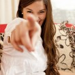 Girl pointing at you — Stock Photo