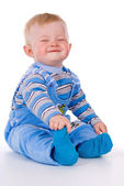 A small child sits and laughs — Stock Photo