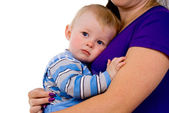 A small child lying on the breast of his mother — Stock Photo