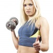 Girl athlete with dumbbell — Stock Photo