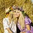 Girls around haystacks and laugh — Stock Photo