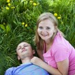 Husband and wife lie on the grass — Stock Photo