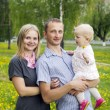Portrait of happy family on nature — Stock Photo #11996875