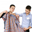Stock Photo: Seller advises clothes