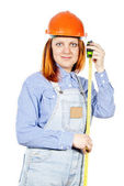 Construction girl with a tape measure isolated — Stock Photo