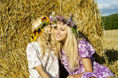 Girls around haystacks and laugh — Stock Photo