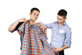 Seller advises clothes — Stock Photo
