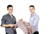 Seller advises the buyer of clothes — Stock Photo