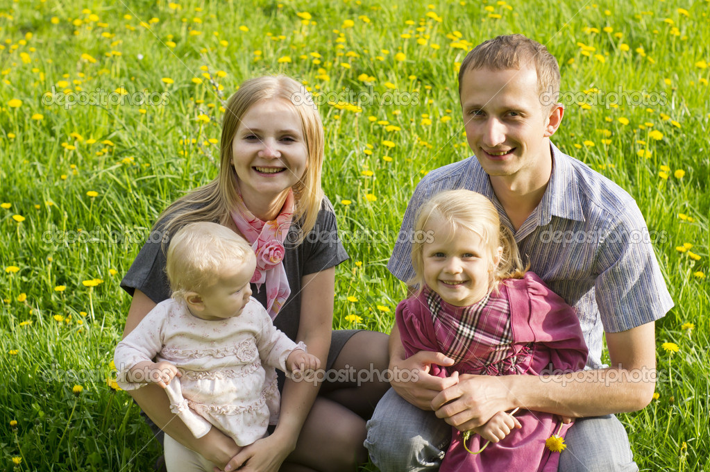 Happy family on a background of grass — Stock Photo #11996524
