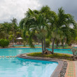 Beach hotel resort swimming pool - Stock Photo
