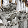 Stock Photo: Stone Lion at Wat Arun.