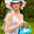 Beautiful bride with a blue trail — Stock Photo