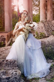 Beautiful girl in white dress with dog — Stok fotoğraf