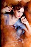 Beautiful girl in blue dress — Stock fotografie