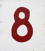 Number eight on white plywood background — Stock Photo