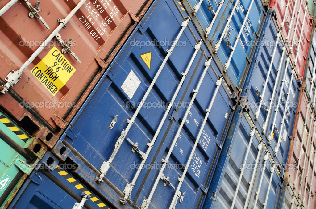 Containers of different colors stacked at docks.  Stock Photo #10801313