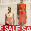 Retail Shop Window - Sale Signs in red — Stock Photo