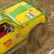 Detailed view of the yellow car in a mud — Stock Photo