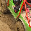 Detailed view of the green  car in a mud — Stok fotoğraf