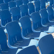 Blue seats in a row — Stock Photo