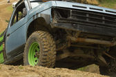 Off-road vehicle in terrain. — Stock Photo