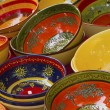 Colorful ceramic bowls ready for sale on the market. - Stock Photo