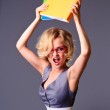 Angry businesswoman with folders — Stock Photo